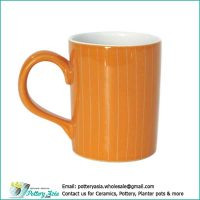 Ceramic mug orange color glaze with stripes