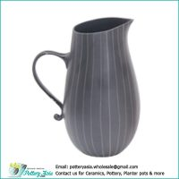 Ceramic jug bulge bottom matte black white stripes