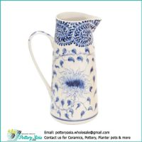 Ceramic jug with handle white and blue hand-drawing