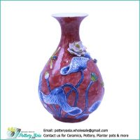 Ceramic vase bulging with flared rim, red glazed