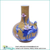 Ceramic vase bulging with lotus and bird, canary color glazed