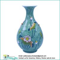 Ceramic vase bulging with lotus and bird, Flared rim, green glazed