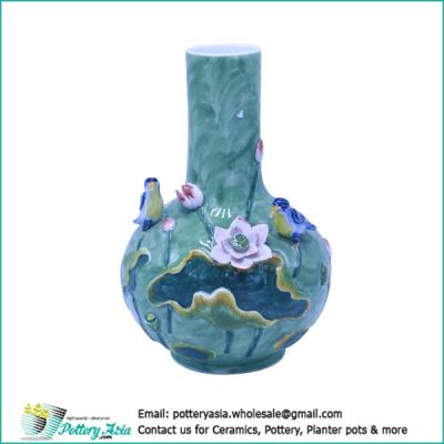 Ceramic vase bulging with lotus and bird, green glazed