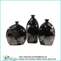 Ornamental ceramic vase oval with small spout, lotus black