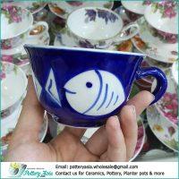 Porcelain tea cup with saucer fish printing