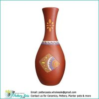 Terracotta vase, oblong shape, slender neck with flared rim